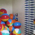 Beach balls in the guest bath complemented the vibrant wall treatment by Samuel Amoia