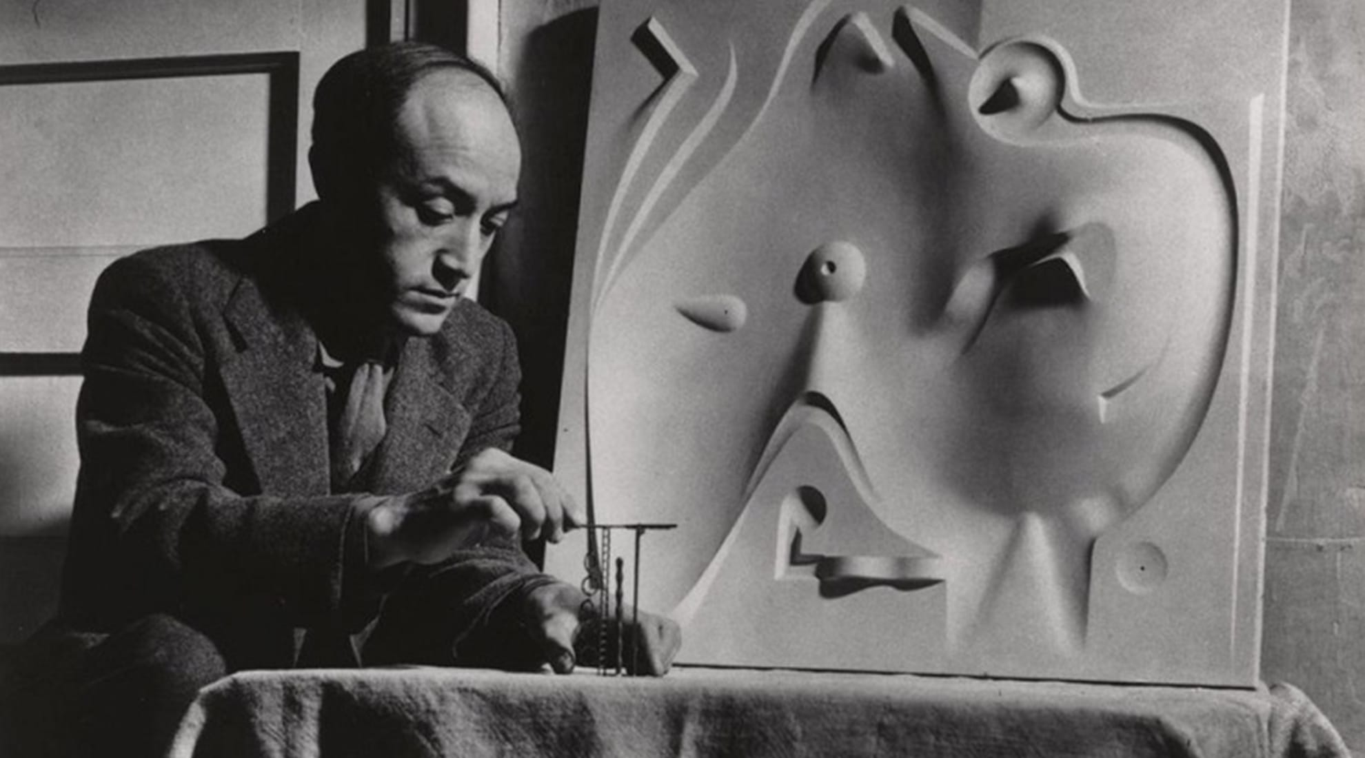Isamu Noguchi circa 1946 with playground model.