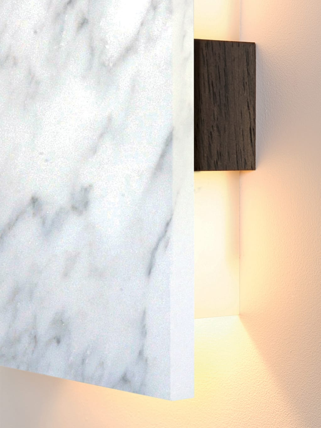 A close-up view of Cerno's Tersus LED Wall Sconce in Carrara Marble and Walnut.