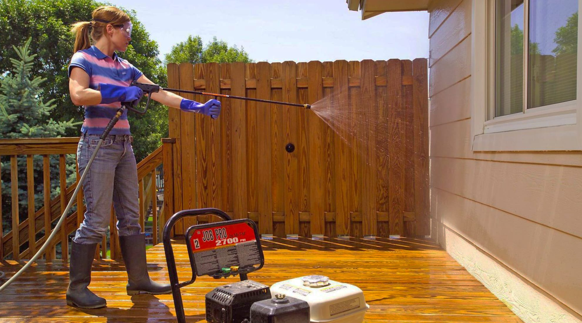 Power washing your home's exterior freshens up finishes and can show you where new coat of a paint is needed.