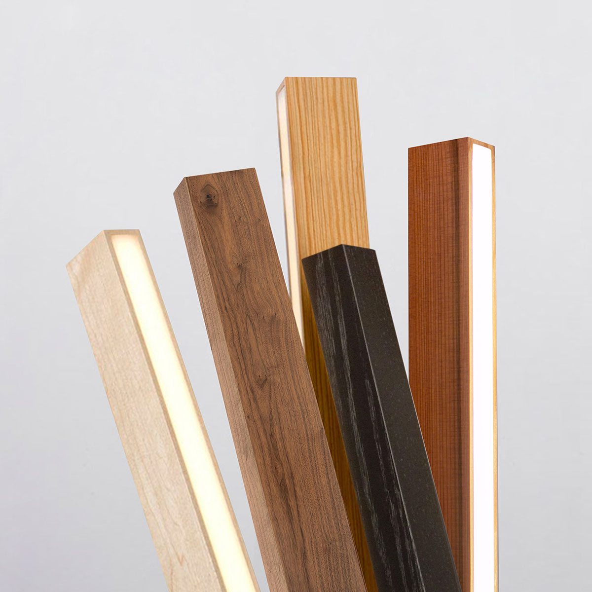 Stickbulb's five material options: maple, walnut, reclaimed heart pine, ebonized oak and reclaimed water tower redwood.
