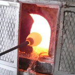 Molten glass is taken from the furnace.